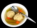 Matzo ball soup on a black background Royalty Free Stock Images