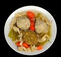 Matzo ball soup on a black background Royalty Free Stock Image