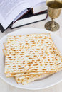 Matzo and wine for passover celebration on a wooden surface Royalty Free Stock Photos