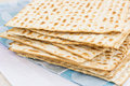 Matzot for passover celebration on a wooden table surface Royalty Free Stock Images