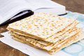 Matzot for passover celebration on a wooden table surface Royalty Free Stock Photography