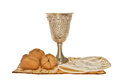 Matzoth silver kiddush cup walnuts and yarmulke passover arrangement with three Royalty Free Stock Photo