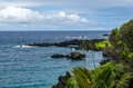 Maui coastline with blue skies and lava rocks Stock Photo