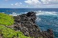 Maui coastline with blue skies and lava rocks Royalty Free Stock Photography