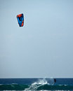 Maui kitesurfer a rides a wave near hawaii s island of Royalty Free Stock Photos