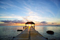 Mauritius sunset jetty silhouette against beautiful in island Royalty Free Stock Image