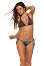Mauve and blue pretty romanian brunette in a bikini Royalty Free Stock Photos