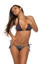 Mauve and blue pretty romanian brunette in a bikini Stock Photo