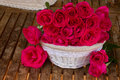 Mauve roses in basket Royalty Free Stock Photo