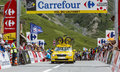 Mavic car on col du lautaret france july the traditional yellow of arives in hautes alpes during the stage of le Royalty Free Stock Photography