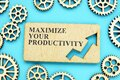 Maximize Your Productivity phrase on the plate and gears Royalty Free Stock Photo