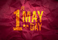 May day international labor day on red crumpled paper texture holiday concept Stock Photos