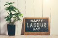 May Day, May 1. Small chalk board with text Labor Day. Internati Royalty Free Stock Photo