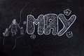 May handwritten on blackboard with family mother day and flowers black chalkboard Stock Images
