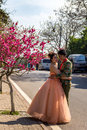 May 2013 - Qingdao, China - Chinese couple in German style clothing making wedding pictures Royalty Free Stock Photo