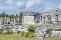 Maya ruins of tulum columns and leaning limestone walls house the columns or great palace at archaeological site in mexico Stock Photo