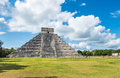 Mayan chichen itza pyramid in mexico on the green grass with cloudy sky Royalty Free Stock Image