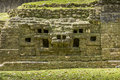 Mayan jaguar temple close up of the left mask built into the in belize Royalty Free Stock Photo