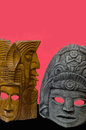 Mayan masks with red background image of a wooden and stone mask against a Royalty Free Stock Photography