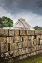 Mayan ruins of chichen itza the big pyramid and the decorations in front it Royalty Free Stock Photo