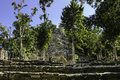 Mayan ruins and hut on bottom of the pyramid known as the church structure a d in coba quintana roo yucatan mexico Stock Image