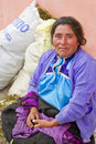Mayan woman in traditional skirt and blouse san cristobal de las casas mexico december sitting next to the wares she is selling Royalty Free Stock Photos