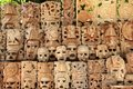 Mayan wood mask rows Mexico handcraft faces Royalty Free Stock Photo