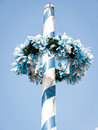 Maypole typical bavarian in front of blue sky Stock Image