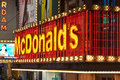 Mc donalds neon lights entrance new york united states may world famous fast food chain along nd street in times square new york Royalty Free Stock Image