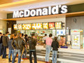 Mc donalds restaurant bucharest romania april people buying fast food from mcdonalds on april in bucharest romania mcdonalds is Royalty Free Stock Photography