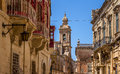 Mdina balconies street in full of and the carmelite convent in the end of the street Royalty Free Stock Photography