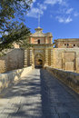 Mdina city gates malta entrance to it is a fortified in the northern region of which served as the island s capital from antiquity Stock Image