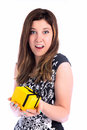For me closeup of woman holding yellow gift box with black bow Stock Photos