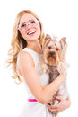 Me and my glamorous friend beautiful young blond hair woman carrying yorkshire terrier in pink clothes smiling while standing Royalty Free Stock Photos
