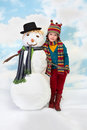 Me and my snowman shy little girl posing with her Royalty Free Stock Photos