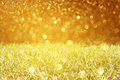 Meadow and golden glitter lights pic Stock Photo