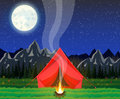 Meadow with grass and camping. Royalty Free Stock Photo