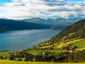 Meadows on the fjords and village norvegian Royalty Free Stock Photography
