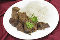 Meal of indian fried liver mutton with onion and spices to make a traditional kerala south india fry served with basmati long Royalty Free Stock Images