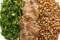 Rye, steak and cabbage meal on white plate. Overhead close up of Royalty Free Stock Photo