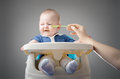 Meal time baby refuses to eat and makes funny grimace he is blonde with blue eyes and is having breakfast lunch or dinner a hand Stock Photos