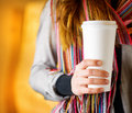 Meal time young woman holding a tumbler of coffee in cafe Stock Image