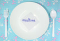 Mealtime white empty plastic plate and cutlery with card remind for Royalty Free Stock Photography