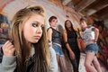 Mean group near sad girl of people looking over at insecure teen Royalty Free Stock Photography