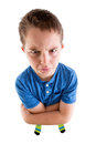 Mean Young Boy Looking at High Angled Camera Royalty Free Stock Photo