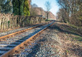 Meandering rails at close old railway tracks on a gravel bed twisting through the landscape Stock Images