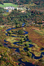 Meandering river aerial view in autumn of the housatonic crossing new lenox road near pittsfield in the berkshires of Royalty Free Stock Photo