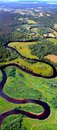 Meandering river view from above green landscape of the winding Stock Photo