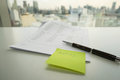 Meassage note of meeting on green postit Royalty Free Stock Photo