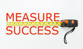 Measure success conceptual using measuring tape Stock Image